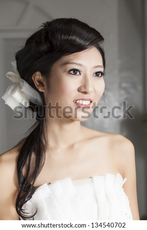 Portrait of a beautiful elegant young woman. - stock photo