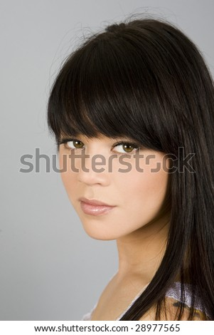 Portrait of a beautiful exotic woman - stock photo