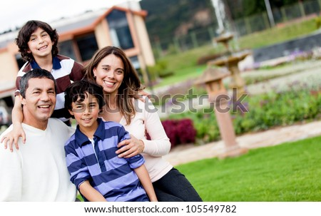 Portrait of a beautiful family looking very happy and smiling - stock photo
