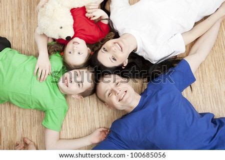Portrait of a beautiful family: parents and children play together - stock photo