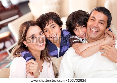 Portrait of a beautiful family smiling at home - stock photo