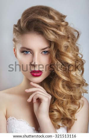 Portrait of a beautiful fashion bride,sweet and sensual.Wedding make up and hair.glamor closeup portrait of  sexy stylish young woman model with bright makeup, with red lips, with perfect clean skin - stock photo