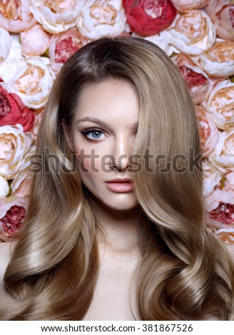 Portrait of a beautiful fashion bride, sweet and sexy. Wedding make up and hair. Flowers background. Blue eyes. Perfect skin. Summer style. - stock photo
