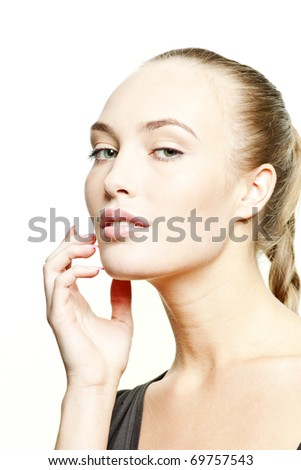 Portrait of a beautiful fashion female model on white background with copy space for text. - stock photo