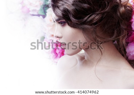 Portrait of a beautiful fashion girl, sweet and sensual. Beautiful makeup and messy romantic hairstyle. Flowers background.  - stock photo