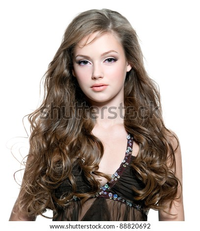 Portrait of a beautiful fashion model with  long curly hairs - stock photo
