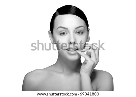 Portrait of a beautiful female blue eyes model with hand near mouth on white background - stock photo