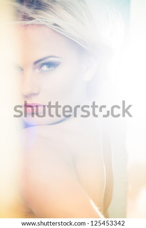 Portrait of a beautiful female model in bleached light - stock photo