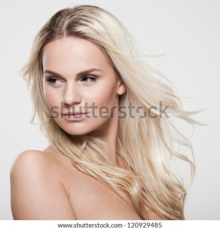 Portrait of a beautiful female model on gray background