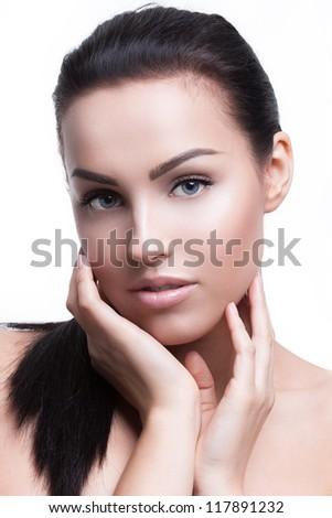 Portrait of a beautiful female model on white background - stock photo