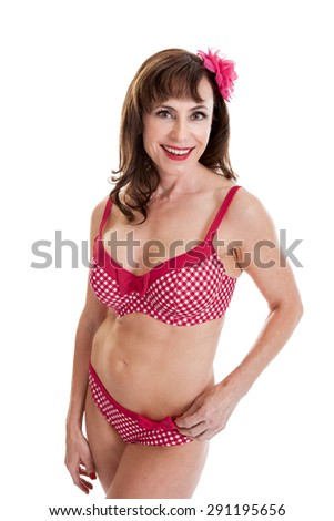 Portrait of a beautiful fit mid 40s retro woman wearing bathing suit isolated on white - stock photo
