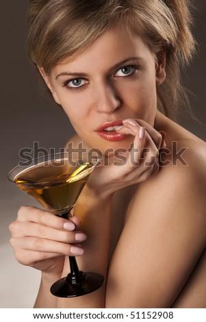 Portrait of a beautiful, flirtatious model biting her fingernail - focus on right eye - stock photo