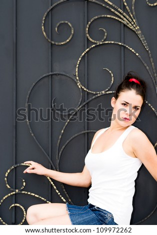 Portrait of a beautiful girl against vintage background - stock photo