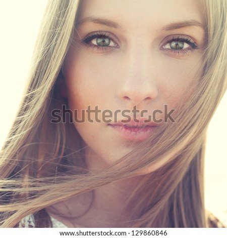 portrait of a beautiful girl closeup. pictures in warm colors - stock photo