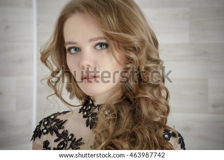 Portrait of a beautiful girl in a beautiful dress with patterns by Parliament