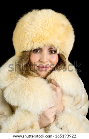 portrait of a beautiful girl in a beige coat and hat