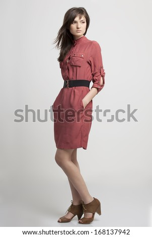 portrait of a beautiful girl in a fashionable clothes - stock photo