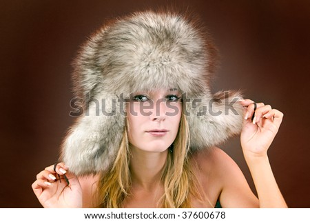 portrait of a beautiful girl in a fur hat - stock photo