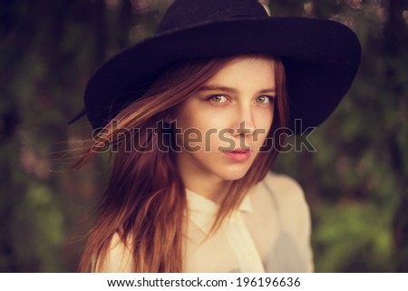 portrait of a beautiful girl in a hat - stock photo