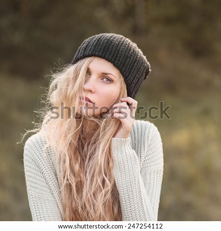 portrait of a beautiful girl in a hat hipster - stock photo