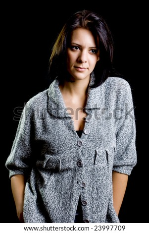 portrait of a beautiful girl in a pullover - stock photo