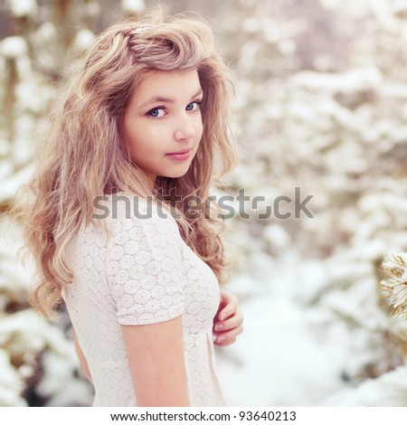 portrait of a beautiful girl in a sunny forest - stock photo