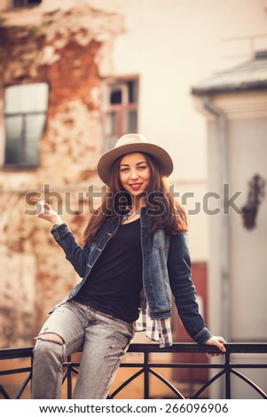 portrait of a beautiful girl in a urban style looking at the camera - stock photo