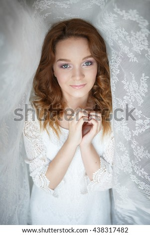 Portrait of a beautiful girl in a white dress - stock photo