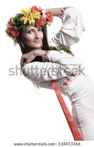 portrait of a beautiful girl in national costume - stock photo