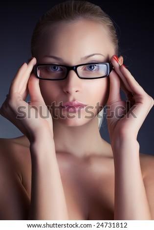 Portrait of a beautiful girl in stylish glasses, studio shot - stock photo