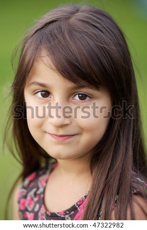 Portrait of a beautiful girl in the garden -focus in the eye- - stock photo