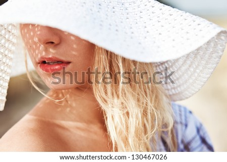 portrait of a beautiful girl in the hat - stock photo