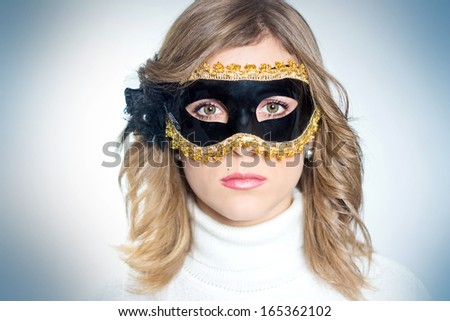 portrait of a beautiful girl in the masquerade mask - stock photo