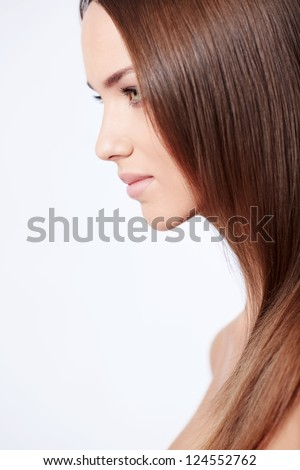 Portrait of a beautiful girl in the studio - stock photo