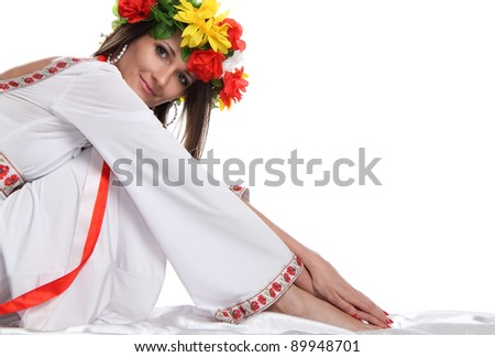 portrait of a beautiful girl in the Ukrainian national costume - stock photo
