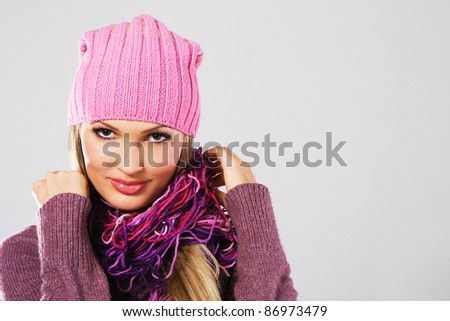 Portrait of a beautiful girl in warm clothing
