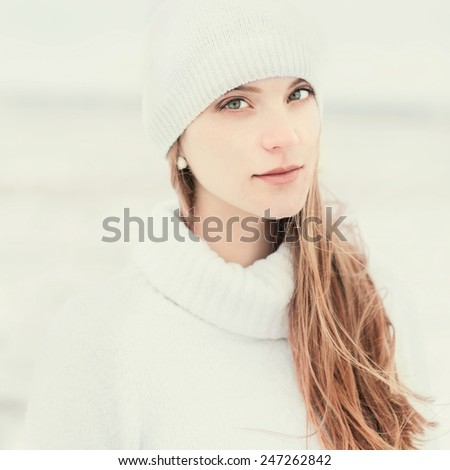 portrait of a beautiful girl in winter hat - stock photo