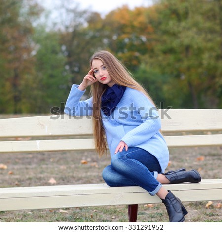 portrait of a beautiful girl on a cold windy day - stock photo