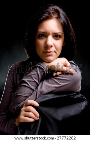 portrait of a beautiful girl, on black - gray background - stock photo