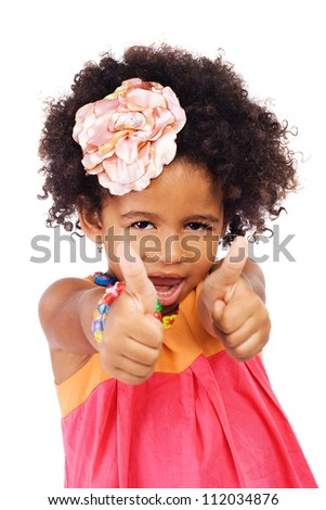 Portrait of a beautiful girl showing thumbs up - stock photo