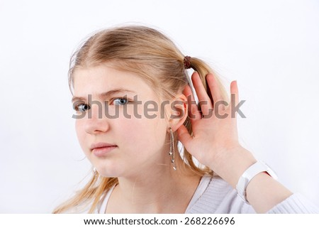 Portrait of a beautiful Girl who can't hear well - stock photo
