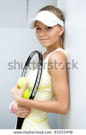 portrait of a beautiful girl with a tennis racket - stock photo