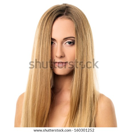 Portrait of a beautiful girl with blonde straight hair posing with naked shoulders over a white background