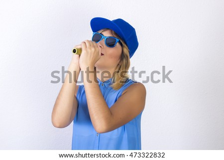 Portrait of a beautiful girl with complements on head singing with mic