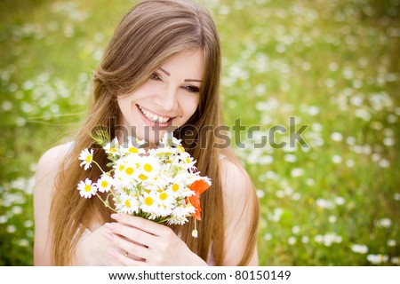 portrait of a beautiful girl with daisies - stock photo