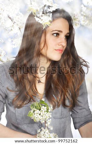 Portrait of a Beautiful Girl with Flowers from a Blooming Tree - stock photo