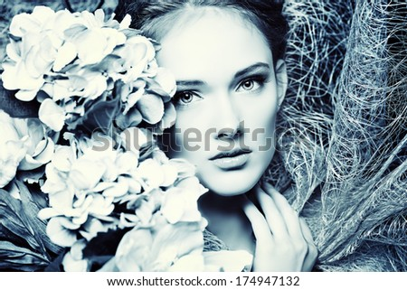 Portrait of a beautiful girl with flowers. Spring. - stock photo
