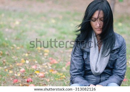 Portrait of a beautiful girl with flying hair in the wind against a background in the forest - stock photo