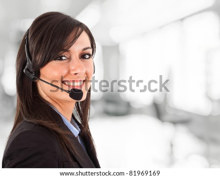 Portrait of a beautiful girl with headset - stock photo