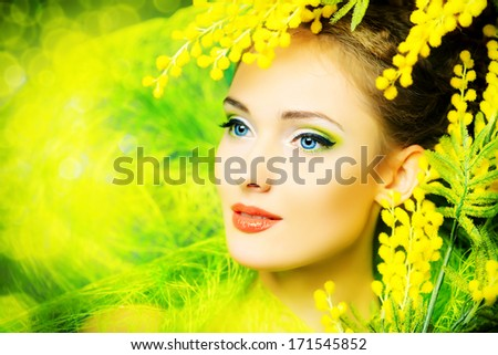 Portrait of a beautiful girl with mimosa flowers. Spring. - stock photo